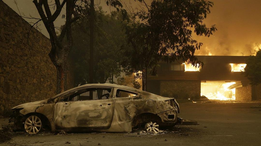 More than a dozen wildfires raged across Northern California on Tuesday, October 10, 2017 morning, with the biggest ones scorching the state's famous wine country, killing several people and burning more than 1,500 homes and businesses, authorities said.