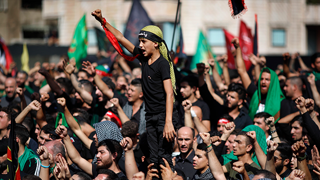 (AP Photo/Hassan Ammar) Lebanese Shiite supporters of Hezbollah shouts slogans against the U.S and Israel during activities marking the holy day of Ashoura, in southern Beirut, Lebanon, Sunday, Oct. 1, 2017.