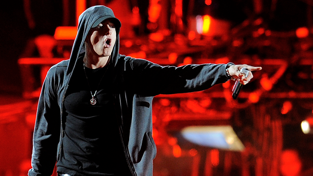 Eminem performs onstage during Dr. Dre and Snoop Dogg's headlining performance on the first weekend of the 2012 Coachella Valley Music and Arts Festival, Sunday, April 15, 2012, in Indio, Calif. (AP Photo/Chris Pizzello)