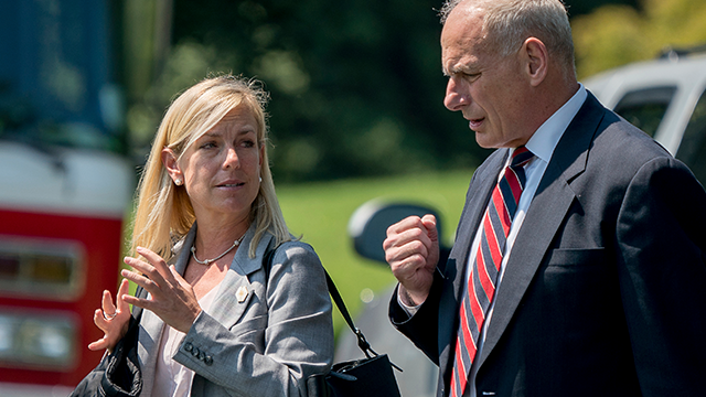 (AP Photo/Andrew Harnik) White House Chief of Staff John Kelly and Deputy Chief of Staff Kirstjen Nielsen speak together as they walk across the South Lawn of the White House in Washington, Tuesday, Aug. 22, 2017, to board Marine One...