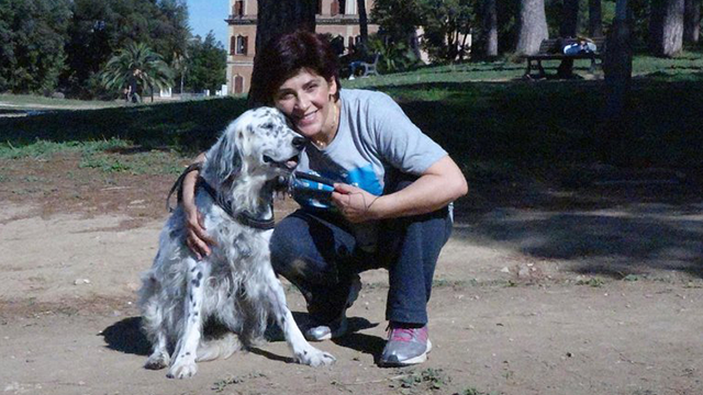(Str/ANSA via AP)This undated photo made available Thursday, Oct. 12, 2017, shows an Italian librarian (name not available) who has won the right from her employer to use family sick leave to care for her ailing pet instead of having to use vacation days,