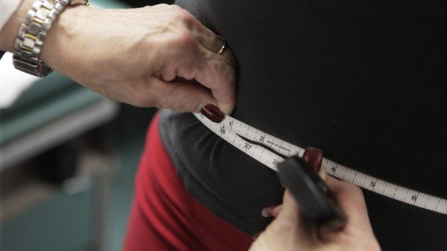 n this Jan. 20, 2010, file photo, a waist is measured during an obesity prevention study at Rush University Medical Center in Chicago.  (AP Photo/M. Spencer Green, File)