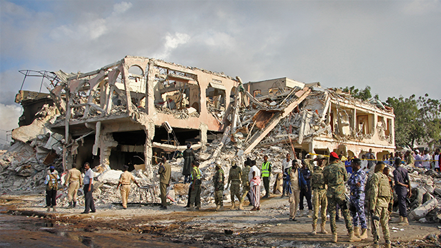 (AP Photo/Farah Abdi Warsameh) Somali security forces and others gather and search for bodies near destroyed buildings at the scene of Saturday's blast, in Mogadishu, Somalia Sunday, Oct. 15, 2017.