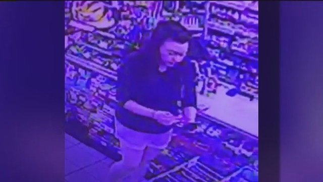 Police: Woman stole credit cards from man having seizure