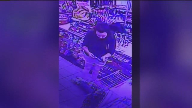 Authorities in the Salt Lake City area are trying to identify a woman who stole a credit card from the wallet of a convenience store clerk as he was having a seizure. (KSTU via CNN)