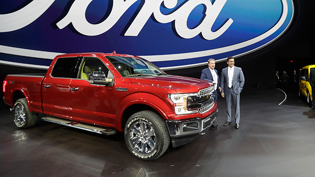 Ford Motor Co. Executive Chairman Bill Ford, left, and Chief Executive Mark Fields stand next to a Ford F-150 truck at the North American International Auto show, Monday, Jan. 9, 2017, in Detroit. (AP Photo/Carlos Osorio)