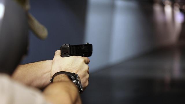 In this Jan. 4, 2013, photo, a man fires a hand gun at Sandy Springs Gun Club and Range, in Sandy Springs, Ga. (AP Photo/Robert Ray)