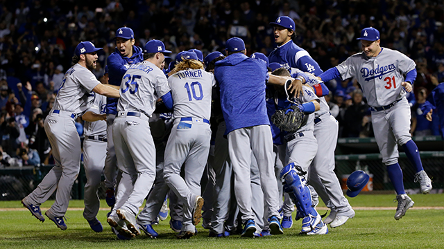 The Los Angeles Dodgers players celebrate after Game 5 of baseball's National League Championship Series against the Chicago Cubs, Thursday, Oct. 19, 2017, in Chicago. The Dodgers won 11-1 to win the series and advance to the World Series. (AP Photo)
