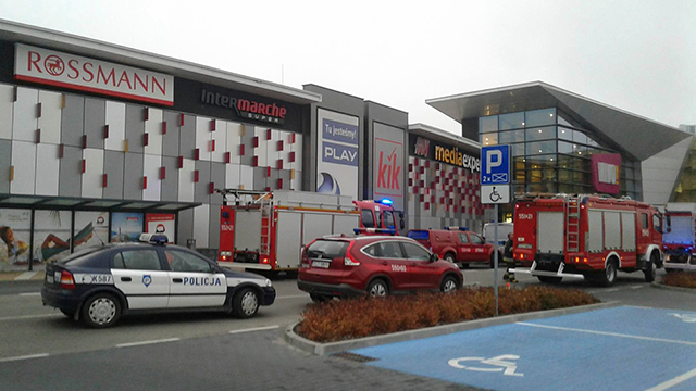 Police and firefighters' cars and trucks stand in front of the VIVO! shopping mall where a 27-year-old man attacked people with a knife killing one person and injuring several others in southeastern Poland. (AP Photo/Rafal Baran)