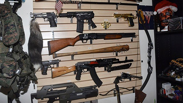 """a weapons cache is shown in the home of Randall Drake. Sheriff's deputies conducting a child porn raid on the home found an arsenal of guns and explosives and a homemade silencer, along with a note promising """"bloody revenge."""" (Pinellas County Sheriff)"""