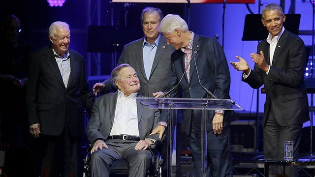 Former Presidents from right, Barack Obama, Bill Clinton, George W. Bush, George H.W. Bush and Jimmy Carter gather on stage during a hurricanes relief concert in College Station, Texas, Saturday, Oct. 21, 2017. (AP Photo/LM Otero)