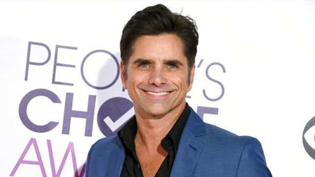 (Photo by Jordan Strauss/Invision/AP, File). FILE - In this Jan. 18, 2017 file photo, John Stamos arrives at the People's Choice Awards at the Microsoft Theater in Los Angeles. Stamos announced his engagement to actress Caitlin McHugh on social media O...