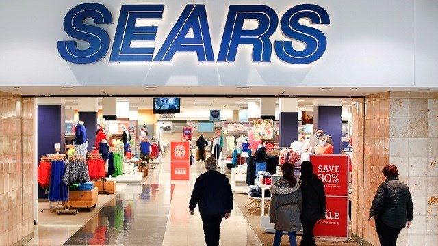 Shoppers enter the Sears department store at the Tri-County Mall, Wednesday, March 22, 2017, in Springdale, Ohio.  (AP Photo/John Minchillo)