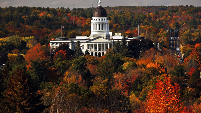 The State House is surrounded by fall foliage Monday, Oct. 23, 2017, in Augusta, Maine. (AP Photo/Robert F. Bukaty)