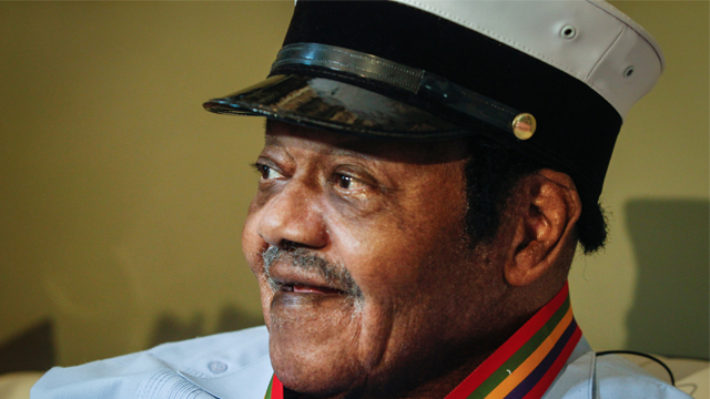 "Legendary musician Fats Domino is named ""Honorary Grand Marshall"" of the Krewe of Orpheus, the star-studded Carnival club that traditionally parades the night before Mardi Gras, Friday, Dec. 20, 2013 in New Orleans. (AP Photo/Doug Parker)"
