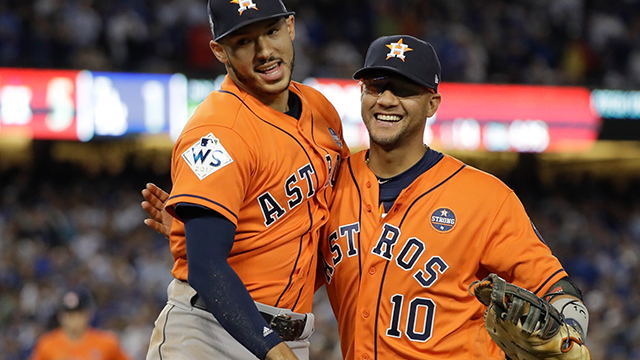 Houston Astros' Carlos Correa celebrates with Yuli Gurriel during the sixth inning of Game 7 of baseball's World Series against the Los Angeles Dodgers Wednesday, Nov. 1, 2017, in Los Angeles. (AP Photo/David J. Phillip)
