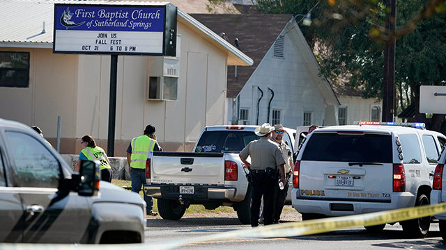 Law enforcement officers gather in front of the First Baptist Church of Sutherland Springs after a fatal shooting, Sunday, Nov. 5, 2017, in Sutherland Springs, Texas. (AP Photo/Darren Abate)
