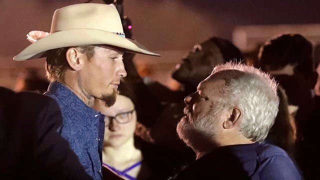 Stephen Willeford, right, hugs Johnnie Langendorff during a vigil for the victims of the First Baptist Church shooting Monday, Nov. 6, 2017, in Sutherland Springs, Texas. (AP Photo/David J. Phillip)