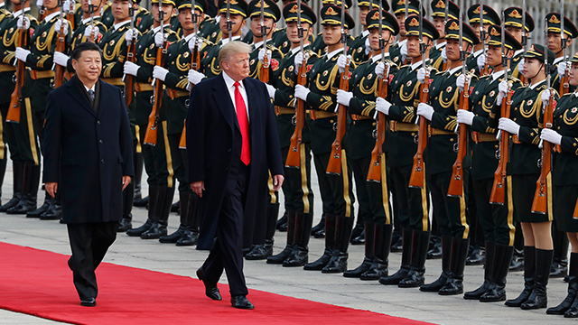 U.S. President Donald Trump, right, and Chinese President Xi Jinping attend a welcome ceremony at the Great Hall of the People in Beijing Thursday, Nov. 9, 2017. (AP Photo/Andy Wong)