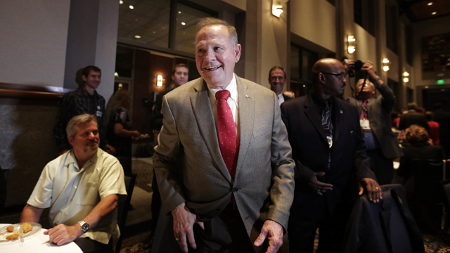 Former Alabama Chief Justice and U.S. Senate candidate Roy Moore, greets supporters before his election party, Tuesday, Sept. 26, 2017, in Montgomery, Ala. (AP Photo/Brynn Anderson)