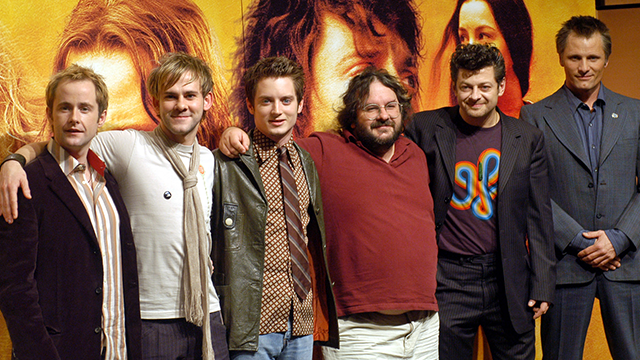 "(AP Photo/Koji Sasahara) Film director Peter Jackson, third from right, of ""The Lord of the Rings: The Return of the King,"" its leading actor Elijah Wood, third from left, and his supporting actors line up before photographers during a press conference..."