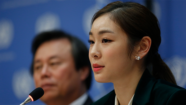 (AP Photo/Bebeto Matthews) South Korea's 2010 Olympic gold medalist figure skater Yuna Kim, right, speaks during a press conference, Monday Nov. 13, 2017 at U.N. headquarters.