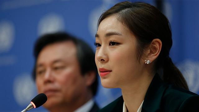 (AP Photo/Bebeto Matthews) South Korea's 2010 Olympic gold medalist figure skater Yuna Kim, right, speaks during a press conference, Monday Nov. 13, 2017 at U.N. headquarters.