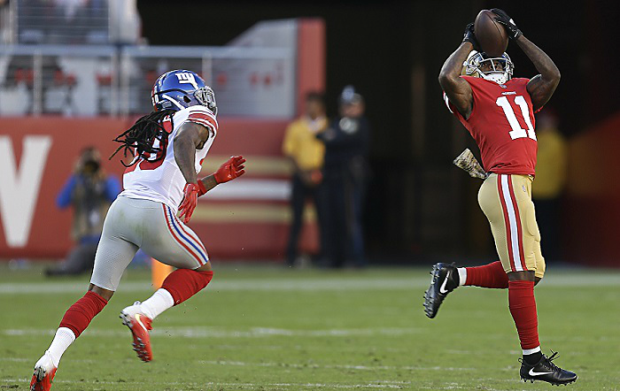 San Francisco 49ers wide receiver Marquise Goodwin catches a touchdown pass in front of New York Giants cornerback Janoris Jenkins, left, during the first half of an NFL football game in Santa Clara, Calif., Sunday, Nov. 12, 2017. (AP Photo/Ben Margo)