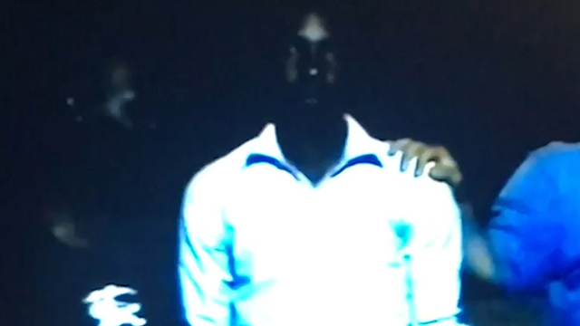 (Source: CNN) One of the unidentified men being sold in the grainy cell phone video obtained by CNN is Nigerian. He appears to be in his twenties and is wearing a pale shirt and sweatpants.