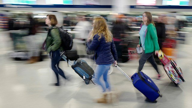 Nearly 100 million Americans are going to be traveling this holiday season, a new survey has discovered. (AP Photo/Mark Lennihan)