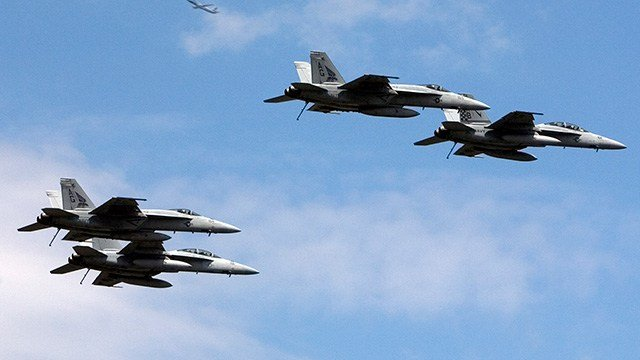 F/A-18 Hornet fighters fly in formation up New York's Hudson River as a commercial airplane passes overhead, part of Fleet Week 2008 NYC on Wednesday May 21, 2008. (AP Photo/Richard Drew)