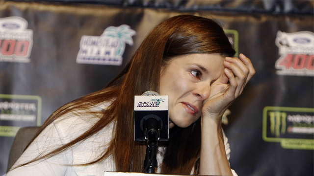 Danica Patrick wipes away tears as he speaks with the media during a news conference before Sunday's NASCAR Cup Series auto race at Homestead Miami Speedway in Homestead Fla. Friday Nov. 17 2017