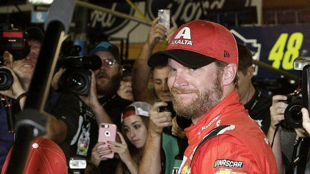 Dale Earnhardt Jr. is surrounded upon getting out of his car after a NASCAR Cup Series auto race at Homestead-Miami Speedway in Homestead, Fla., Sunday, Nov. 19, 2017. (AP Photo/Terry Renna)