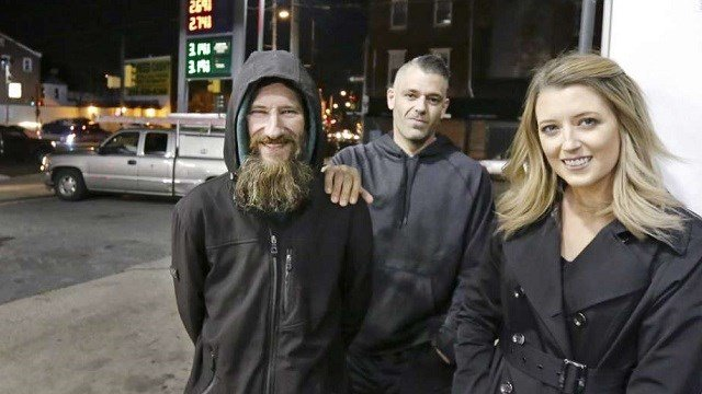 (Elizabeth Robertson/The Philadelphia Inquirer via AP) In this Nov. 17, 2017 photo, Johnny Bobbitt Jr., left, Kate McClure, right, and McClure's boyfriend Mark D'Amico pose at a CITGO station in Philadelphia. When McClure ran out of gas, Bobbitt, who ...