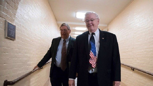(J. Scott Applewhite/The Associated Press) Rep. Michael Burgess (left), R-Texas, and Rep. Joe Barton, R-Texas, walked to a meeting with fellow House Republicans earlier this month as work in Congress resumed after the August recess.