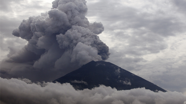 Clouds of ashes rise from the Mount Agung volcano erupting in Karangasem, Bali, Indonesia, Tuesday, Nov. 28, 2017. Mount Agung volcano on Bali has erupted for the first time in more than half a century.  (AP Photo/Firdia Lisnawati)