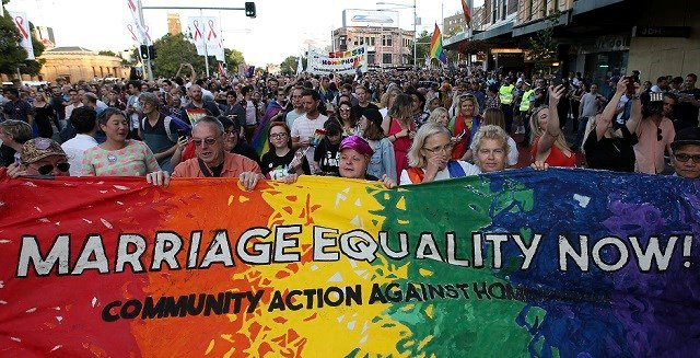 (AP Photo/Rick Rycroft) Members of the gay community and their supporters celebrate the result of a postal survey calling for gay marriage right in Sydney, Australia, Wednesday, Nov. 15, 2017.