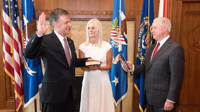Chris Wray is seen here being sworn in as FBI Director by Attorney General Sessions in a private swearing in ceremony at the Department of Justice on August 2, 2017. (Full credit: Matthew T. Nichols for the Department of Justice)