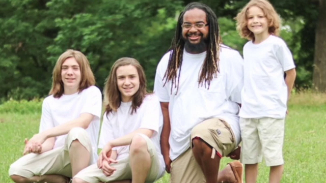A 29-year-old single father decided to adopt his three boys because he believes everyone deserves a loving family. (Barry Farmer, WTVR via CNN)