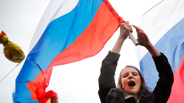 Demonstrators shout slogans and wave Russian flags during a rally in Moscow, Russia, Saturday, Oct. 7, 2017.  (AP Photo/Alexander Zemlianichenko)