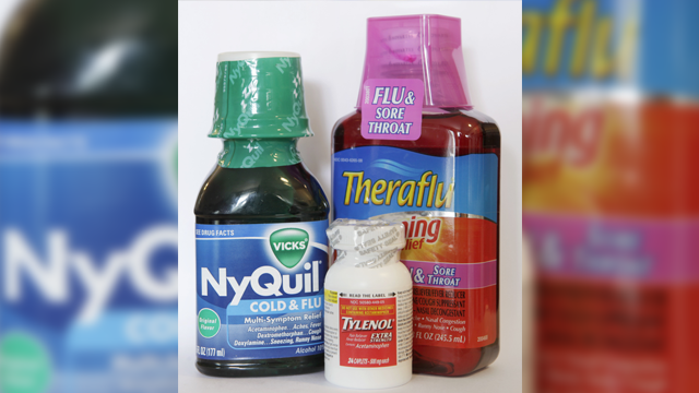 Bottles of NyQuil left Tylenol center front and Theraflu right all containing acetaminophen appear together in Walpole Mass. Tuesday