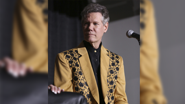 """Artist Randy Travis speaks at a press conference before his """"1 Night. 1 Place. 1 Time.: A Heroes and Friends Tribute to Randy Travis"""" at Bridgestone Arena on Wednesday, February 8, 2017 in Nashville, Tenn. (Photo by Laura Roberts/Invision/AP)"""