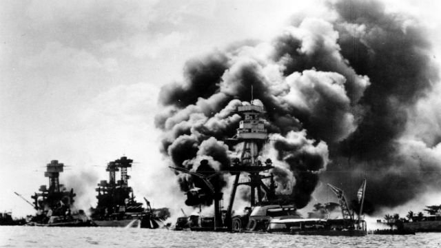 Three U.S. battleships are hit from the air during the Japanese attack on Pearl Harbor on Dec. 7, 1941. Japan's bombing of U.S. military bases at Pearl Harbor brings the U.S. into World War II.  (AP Photo)