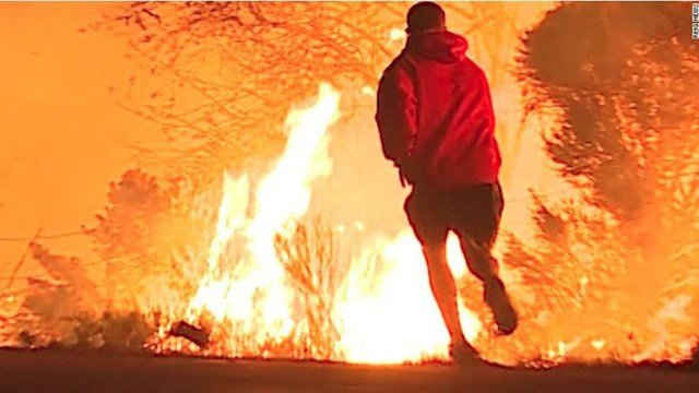 Video of the daring rescue shows a Ventura County highway engulfed in smoke and flames as a man stops on the road as he sees a rabbit jumping into the fire. (RMG News)
