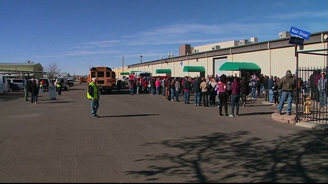 Students gather in the parking lot at Aztec High School in Aztec, New Mexico, after a deadly shooting occurred Thursday, December 7, 2017. (KOAT)
