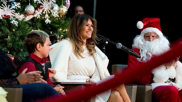 "First lady Melania Trump smiles as she finishes readying ""The Polar Express"" to children at Children's National Medical Center, Thursday, Dec. 7, 2017, in Washington. (AP Photo/Andrew Harnik)"