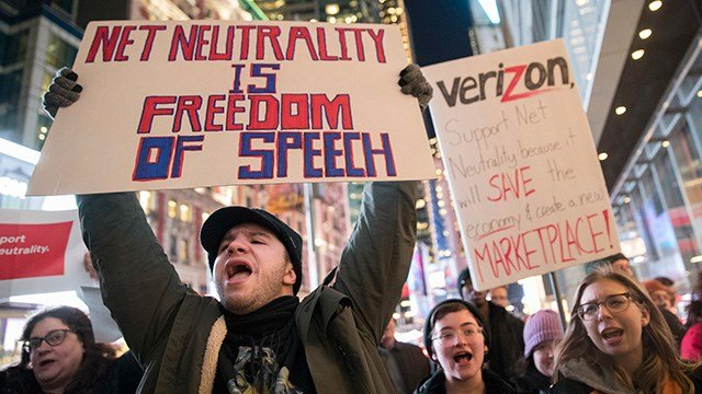 Demonstrators rally in support of net neutrality outside a Verizon store, Thursday, Dec. 7, 2017, in New York. The FCC is set to vote Dec. 14 whether to scrap Obama-era rules around open internet access. (AP Photo/Mary Altaffer)