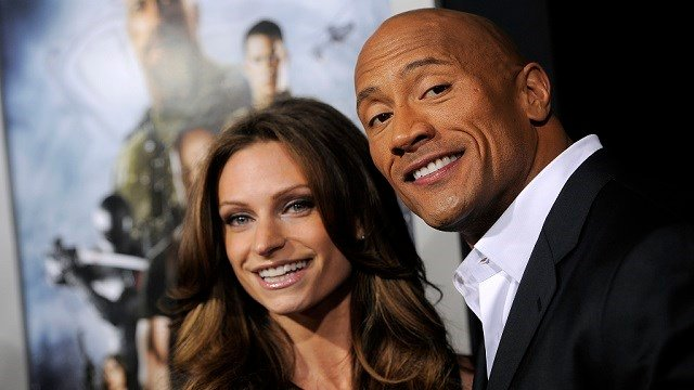 Dwayne Johnson poses with his girlfriend Lauren Hashian on the red carpet. (Photo by Chris Pizzello/Invision/AP)