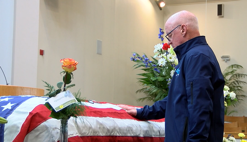 A community member pays his respects at the funeral of Glenn Shelton, 68, on Saturday, Dec. 16, 2017. (Credit: WRTV via CNN)