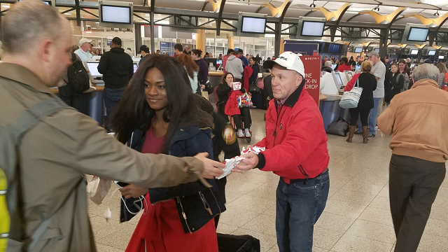 Chick-fil-A CEO Dan Cathy helped hand out sandwiches to travelers stranded at the airport